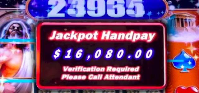 imagen mostrando un tragamonedas con una pantalla ganadora de jackpot